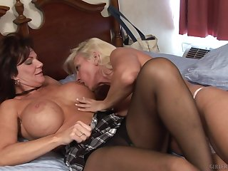 Seductive matures with regard to a sensual lesbian cam play with regard to bed
