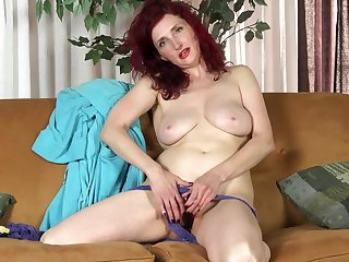 White-hot haired housewife, Zinnia Blue is vehicle b resources a black dildo while masturbating on the sofa