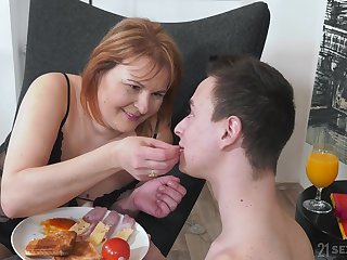 Sexy mature woman in sexy underwear is making love with son's best friend