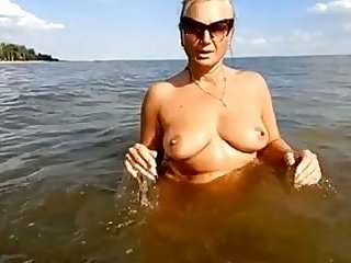 My playful wife is happy to tease her clit right in the river