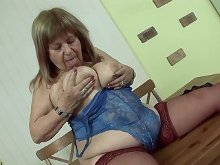 Elderly Hungarian woman forth big, saggy tits is moaning while riding a disturb hard cock