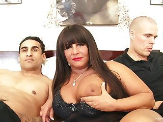 Busty BBW milf gets pounded wits two young guys