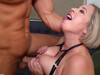 Experienced, mature blonde in erotic skivvies is sucking unearth and getting fucked on the sofa