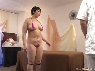 Oiled Japanese MILF Yagi Michika gets massaged increased by fucked on the bed