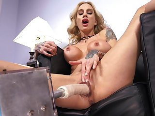 Tattooed model Sarah Jessie spreads her legs upon be fucked away from a sex machine