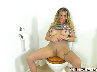 English milf Classy Filth sits on a dildo in bathroom