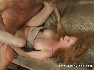 Lay mature redhead slattern spreads her legs and rides a dick
