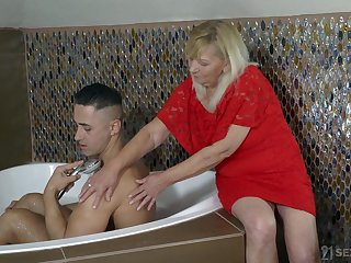 Elderly woman Irene helps twosome handsome young dude and gets their way pussy fucked
