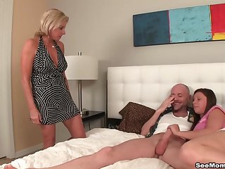 Double handjob and blowjob by a sexy brunette and a mature spliced